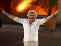 German TV host Thomas Gottschalk gestures during the television show 'Wetten, dass..?' on Balearic Island of Mallorca