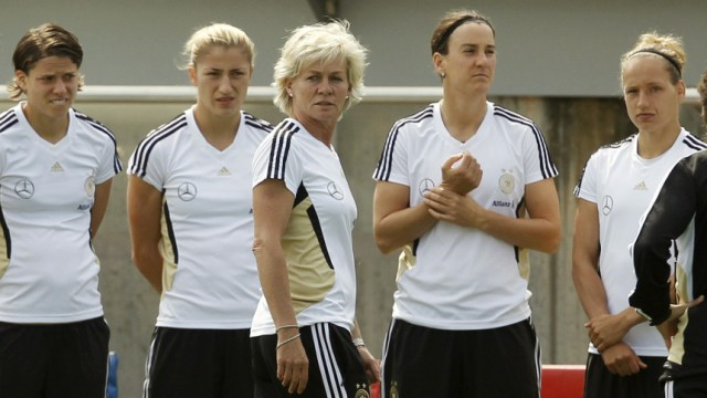 German national soccer coach Silvia Neid  talks to her players during a training session ahead of the Women's World Cup in Berlin