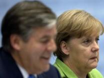 Josef Ackermann, Angela Merkel