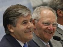 Deutsche Bank CEO Ackermann and German Finance Minister Schaeuble attend financial markets regulation conference in Berlin