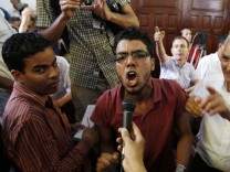 A protester shouts in a courtroom in Tunis