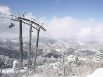 File photo of skiers riding chair lift at Yongpyong resort in Pyeongchang