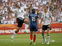 Germany's Grings celebrates her goal with teammate Garefrekes a goal against  France during their Women's World Cup Group A soccer match in Monchengladbach