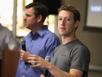 Skype CEO Tony Bates and Facebook CEO Mark Zuckerberg hold a news conference in Palo Alto, California