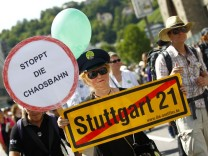 Demonstrators protest against the Stuttgart 21 project in front of the train station in Stuttgart