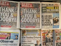 The last edition of News of the World newspaper goes on sale alongside other British Sunday newspapers in London