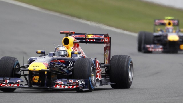 Red Bull Formula One driver Vettel of Germany, drives ahead of team-mate Webber of Australia during the British F1 Grand Prix at Silverstone, central England