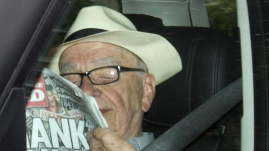 News Corporation CEO Rupert Murdoch is driven into the News International headquarters in London