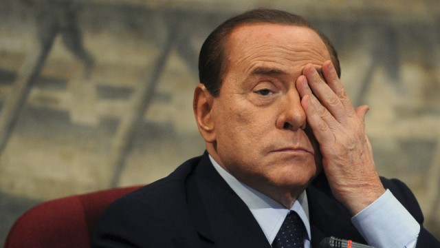 Italian PM Berlusconi gestures during a presentation of a book by Italian member of Parliament Scilipoti in Rome