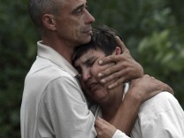Acquaintances of passengers from the Bulgaria tourist boat that sank react at the port of Kazan