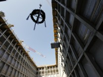 A wreath is lifted during roofing ceremony of future BND headquarters in Berlin