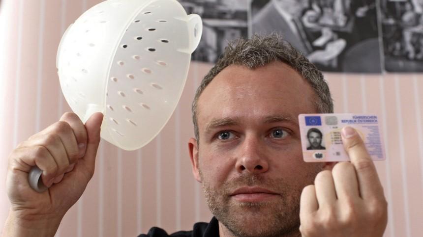 Austrian driver's religious pasta strainer headgear
