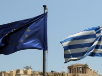 The flags of Greece and European Union are seen in front of the A