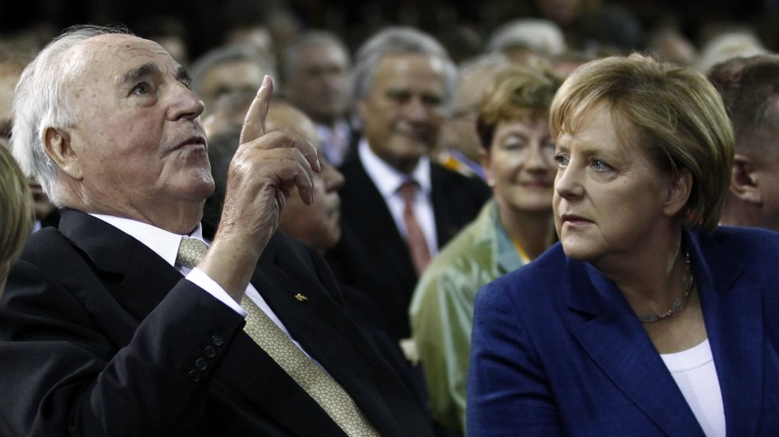 Former German Chancellor Kohl and German Chancellor Merkel attnd a ceremony of Christian Democratic Union (CDU) party to mark the upcoming 20-year anniversary of the German unification in Berlin