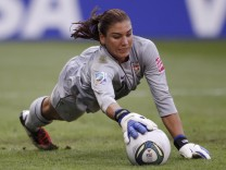 U.S. goalkeeper Hope Solo makes a save during their Women's World Cup quarter-final soccer match against Brazil in Dresden