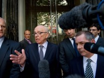 Rupert Murdoch speaks outside the hotel where he met the familly of murdered teenager Milly Dowler in central London
