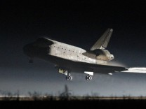 The space shuttle Atlantis lands at the Kennedy Space Center in Cape Canaveral,