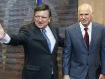 Greece's Prime Minister Papandreou is welcomed by European Commission President Barroso ahead of a meeting in Brussels