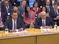 BSkyB Chairman James Murdoch and News Corp Chief Executive and Chairman Rupert Murdoch appear before a parliamentary committee at Portcullis House in London