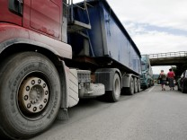 Trucks with goods from Serbia are stopped and turned back at the Merdare border crossing point between Kosovo and Serbia