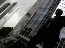 Man walks past headquarters of Germany's Deutsche Bank AG in downtown Frankfurt