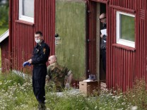 Members of the police and army carry out searches on a farm rented by Anders Behring Breivik in the small rural region of Rena