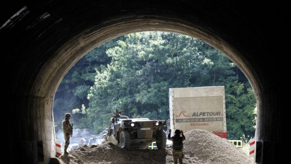 Members of the French KFOR clear a road barricade near the northern Kosovo village of Zubin Potok