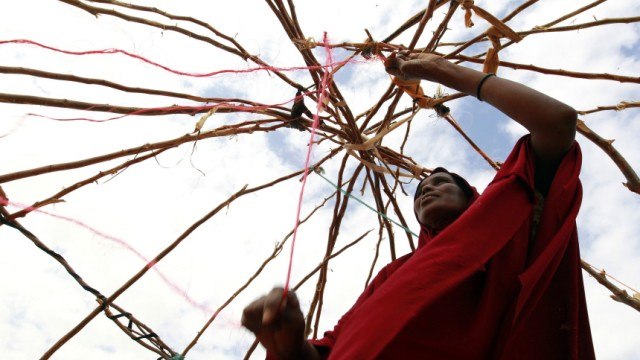 A newly arrived refugee woman constructs a temporary shelter at the Baley settlement near the Ifo extension refugee camp in Dadaab, near the Kenya-Somalia border