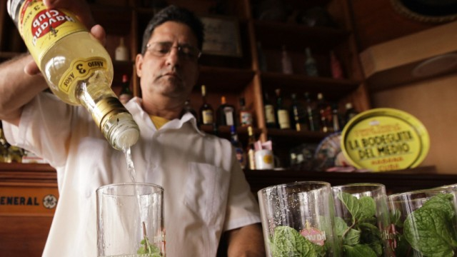 A Cuban bartender prepares traditional 'mojitos', a drink mixed with rum, mint and sugar, in the 'Bodeguita del Medio' bar in Old Havana