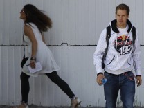 Red Bull Formula One driver Vettel of Germany arrives for the third practice session of the Hungarian F1 Grand Prix at the Hungaroring circuit near Budapest