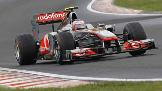 McLaren Formula One driver Button of Britain takes a corner during the Hungarian F1 Grand Prix at the Hungaroring circuit near Budapest