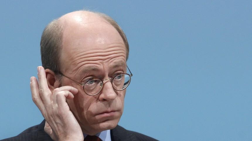 CEO of German reinsurer Munich Re Bomhard gestures during shareholder' meeting in Munich