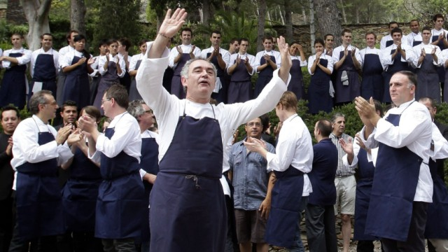 Ferran Adria, chef and co-owner of El Bulli restaurant, gestures during a photo opportunity with his team in Cala Montjoi, near Roses