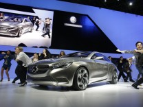 Dancers surround the Mercedes-Benz A Class concept car after it was unveiled at the New York International Auto Show in New York City