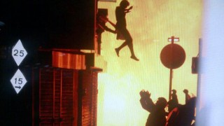 A woman jumps from a burning building in Surrey Street in London
