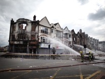 Clean Up Across London After A Third Night Of Rioting