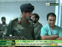 Still image from video footage by Libyan state television shows what it says is Muammar Gaddafi's son Khamis visiting wounded Libyans in a hospital