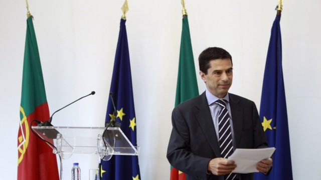 Portugal's Finance Minister Vitor Gaspar leaves the room after a statement to the media in Lisbon