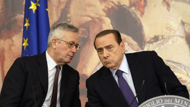 Italy's Economy Minister Giulio Tremonti talks with Italian Prime Minister Silvio Berlusconi during a news conference at Chigi palace in Rome