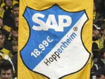 Borussia Dortmund supporters hold up a sign before the German Bundesliga soccer against Hoffenheim in Dortmund