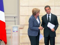 President Nicolas Sarkozy and German Chancellor Angela Merkel Meeting At Elysee Palace