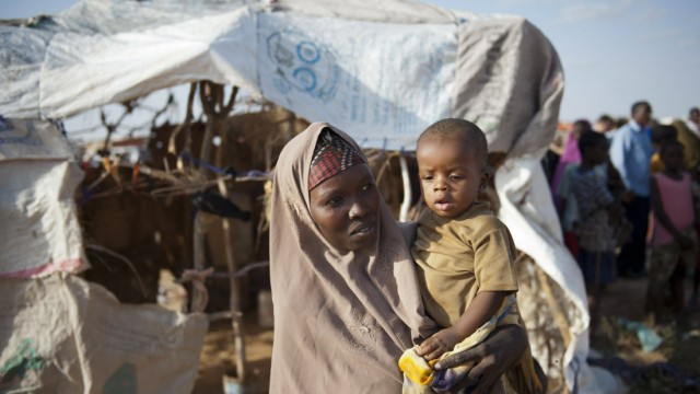 Malaika Mohammad holds a child in a temporary settlement at Garowe