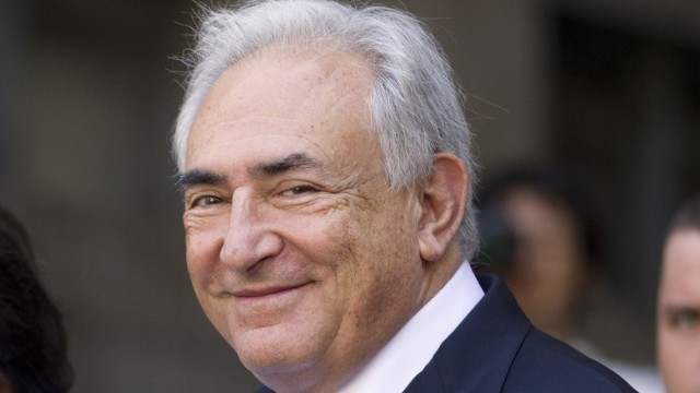 File photo of Dominique Strauss-Kahn smiling as he departs a hearing at the New York State Supreme Courthouse in New York