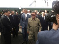 North Korean leader Kim Jong-il takes part in the welcoming ceremony on his arrival in the town of Novobureysk in Amur province