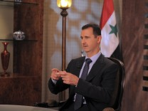 Syria's President Bashar Assad speaks during an interview with Syrian state television in Damascus