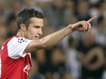 Arsenal's van Persie celebrates after scoring against Udinese during their Champions League soccer match in Udine