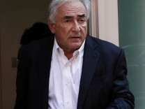 Former Managing Director of the IMF, Dominique Strauss-Kahn, leaves his provisional home in New York