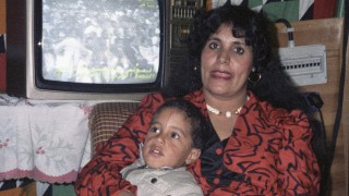 File photo of Safia Gaddafi, wife of Libyan leader Muammar Gaddafi, with one of her children in her Bedouin tent at the Bab-Assaria barracks