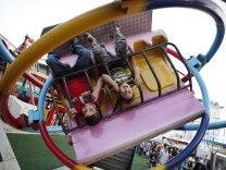 Children enjoy a ride at an amusement park during Eid al-Fitr in Beirut