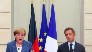 President Nicolas Sarkozy and German Chancellor Angela Merkel Meeting At Elysee Palace